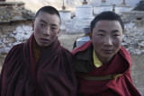 Young monks carrying water