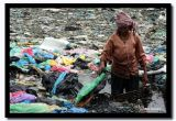 Old Woman Wading in Fetid Water, Steung Mean Chey, Cambodia.jpg