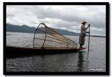 Fisherman standing at the Boat's Edge, Inle Lake, Mynamar.jpg