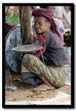 Old Lady Behind the Scales, Inle Lake, Myanmar.jpg