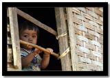 Baby Behind Banboo Bars, Luangprabang Province, Laos.jpg