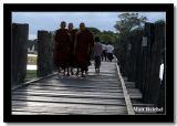 Monks Walking Down the U Bien Bridge, Amarapura, Myanmar.jpg