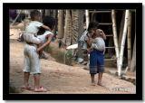 Peeking from Behing Her Brother's Head, Phongsaly, Laos.jpg