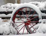 An old snow covered wagon. Sony  a100  Sigma 300mm 2.8 APO.