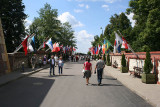 Road into Gate of John Paul II and flags