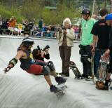 Jason skates while Tony watches