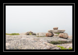 Rock cairns in the fog