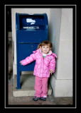 Norah insisting on a picture with the mailbox