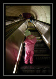 Norah on a beloved escalator