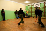 Playing Floor Hockey