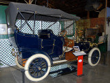 Luxurious early Ford; perhaps 1908 Model T Touring Car.