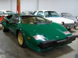 1987 Lamborghini Countach in an unusual green with gold leather interior (yes, it is parked alongside a 1977 AMC Pacer!)