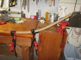 After 20 minutes of steam-up, a small piece of oak spent 10 minutes inside; bent by hand and held in clamps.