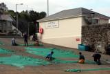 Mending nets outside Mortons