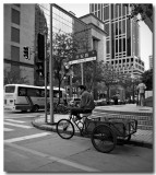 waiting at a crossroad, shanghai city centre...