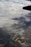 Flying home--note faint glory/plane shadow on clouds.
