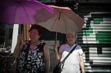 Two Ladies With Umbrellas