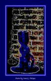 Blue glass vase on window sill.