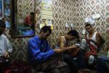 men sewing fez.jpg