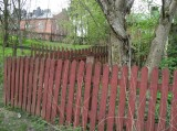 A Red  Board Fence..