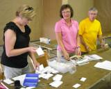Volunteers taking in Fair Entries