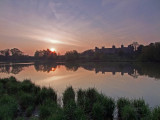 The sun rising over The Mere