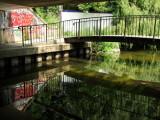 Local  graffitti, footbridge  and  reflections.
