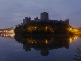 Pembroke  Castle  reflected  in  the  river, at  night.