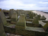 WW2  Anti-tank  concrete  obstructions  on  a  beach.