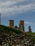 Reculver ; the church towers,with a section of Roman Walling in foreground.
