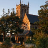 All Saints church lit by the setting sun