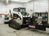 Rented a bobcat to lift the 1400lb dyno into place.JPG