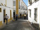whitewashing (and watching) in the back streets of Evora