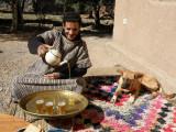 Mansour serving tea