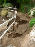 After 1.23 More inches of Rain the Night of July 28, the Main Trail Was Damaged Even More