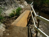 On Monday July 31, BTA Staff did a great job fixing up the washed-out part of the main trail by the catwalk
