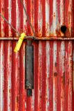 The Handle of the Red Door and the Wire with Yellow Cloth Peg