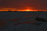 Coucher de soleil sur le fleuve glacé
