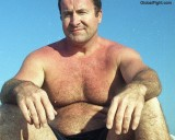 daddy beach suntanning.jpg