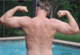 dad flexing pool backyard.jpg