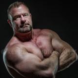 bb powerlifter posing flexed arm muscles.jpg