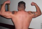 big deltoids tattoos hard muscles.jpg