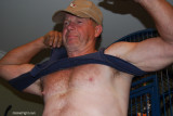 trucker removing tanktop hairychest.jpg