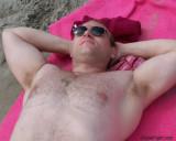 muscleman laying beach suntanning.JPG