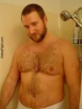 bearish gay man showering gym.jpg
