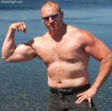 hairy dad flexing beach.jpeg