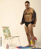 hairy man undressing nudist beach.jpg