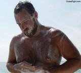 soapy wet man showering beach resort.jpg