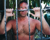 hairy wet man key west jail bars.JPG