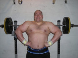 huge monster powerlifter bench pressing champion.jpg